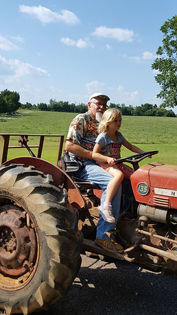 ivy and grandpa on tractor.jpg