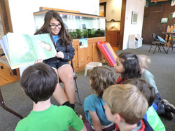 Camp Aide reading to 6-7s