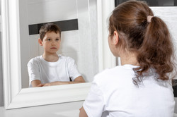 Reflection of a girl in the mirror by a