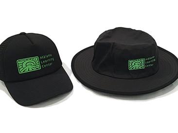 Custom Bucket Hats and Trucker Hats for Malama Learning Center.
