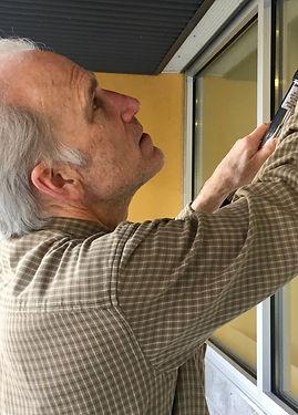 Cleaning a window with squeegee