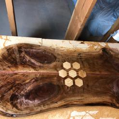 walnut with white oak inlay and clear epoxy finish