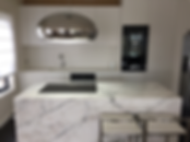 white stone kitchen island and pendent