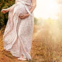 Pregnant Woman in Nature_edited_edited.jpg