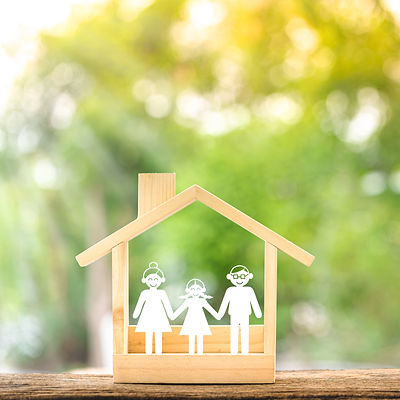 Wooden home with happy family of paper a