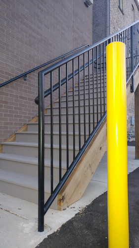 Exterior painting on railings and ballards for Rockford Construction.