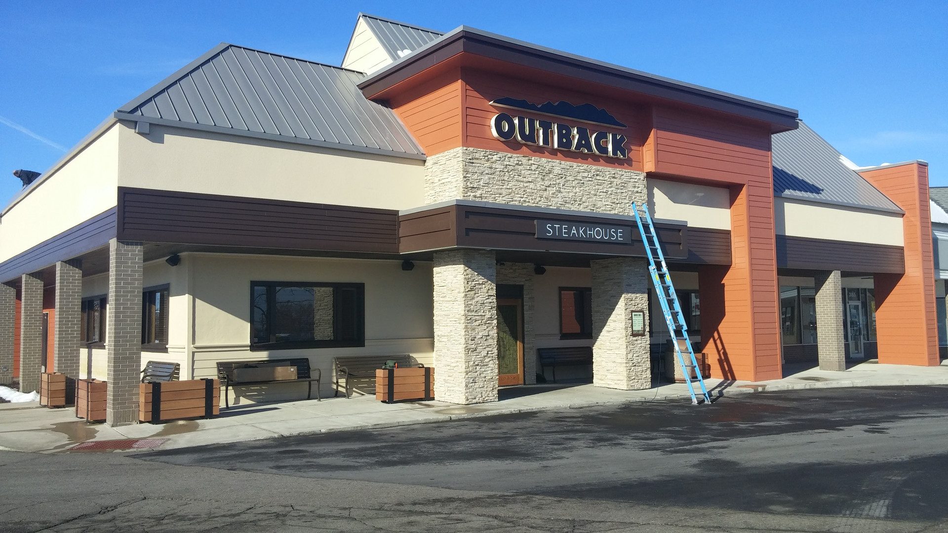 Exterior and Interior painting and staining at an Outback Stakehouse in Ann Arbor, MI for Wolverine Building Group.