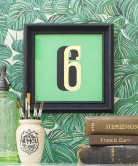A private commission of a number 6. Painted by hand and in reverse with a bespoke green mixed by hand to make a unique - one off - piece of work. The gilding has been applied to the back of the glass using the technique of water gilding and on this piece Umberto chose 23c gold. - The frame was bespoke made by our friends Saddleworth Picture Framers. The guild commended framer works closely with Signs by Umberto to ensure the bespoke glass pieces are framed to the highest standards. - In this piece the number 6 has been designed for the American singer-song writer, John Mayer. The typeface known as 'Mayer' was designed by David A Smith of Torquay who kindly gave Umberto the typeface to use across projects that may require it.   Dimensions:  230 x 230mm  Thickness:  6mm