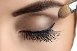 Makeup close-up. Eyebrow makeup, long ey