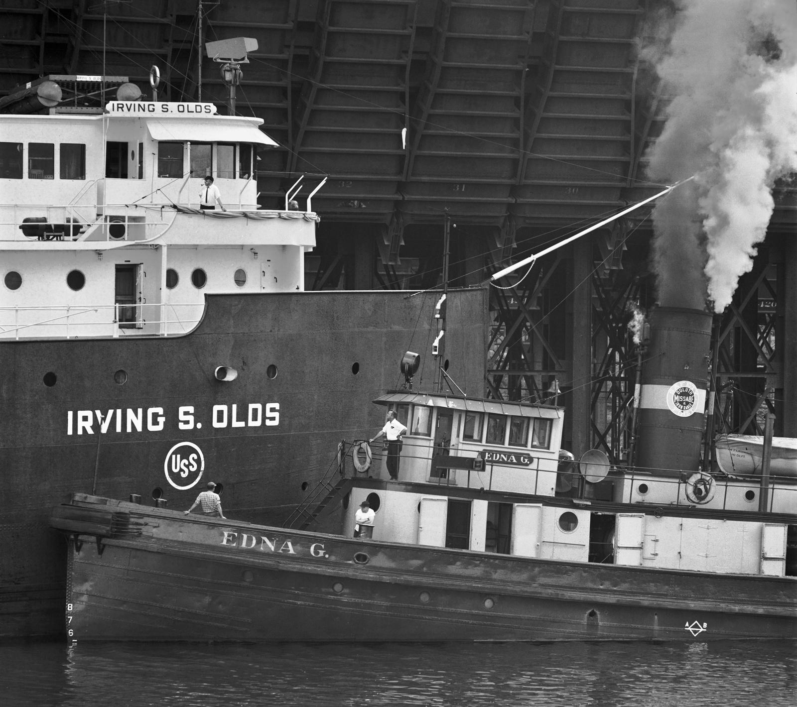 Tug Edna G. Undocking Steamer Irving S. Olds, Two Harbors, Minnesota,1968