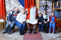 Family visiting Santa at Lapland