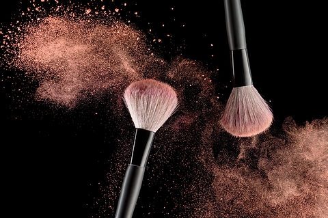 Make-up brush with pink powder explosion