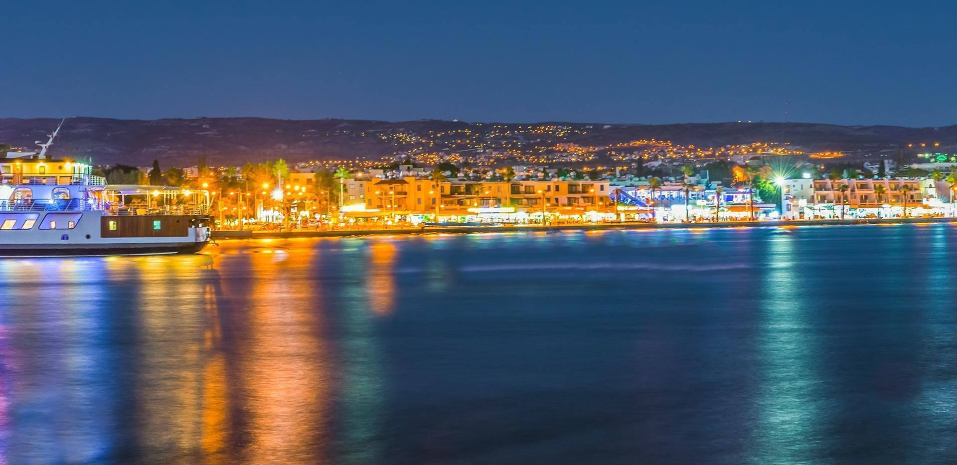 paphos harbour by night