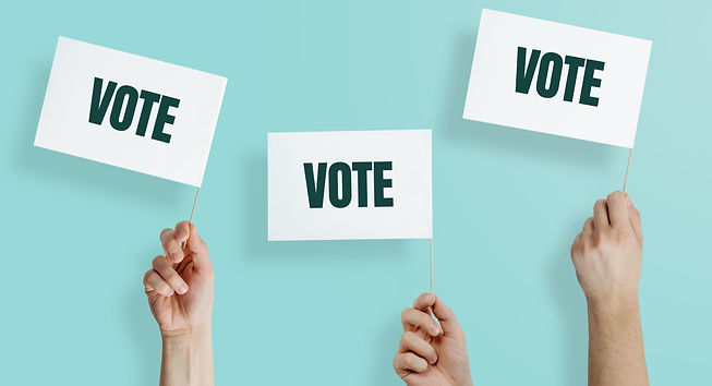 Hands raise the white flags with the word VOTE up. The concept of voting, making choices.