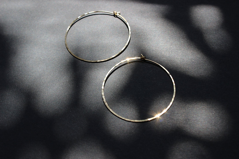 gold hoops on black background