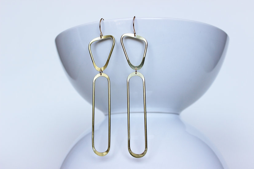 Phora earrings by Loop Jewelry on white bowl