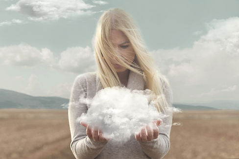 surreal moment , woman holding in her hands a soft cloud.jpg