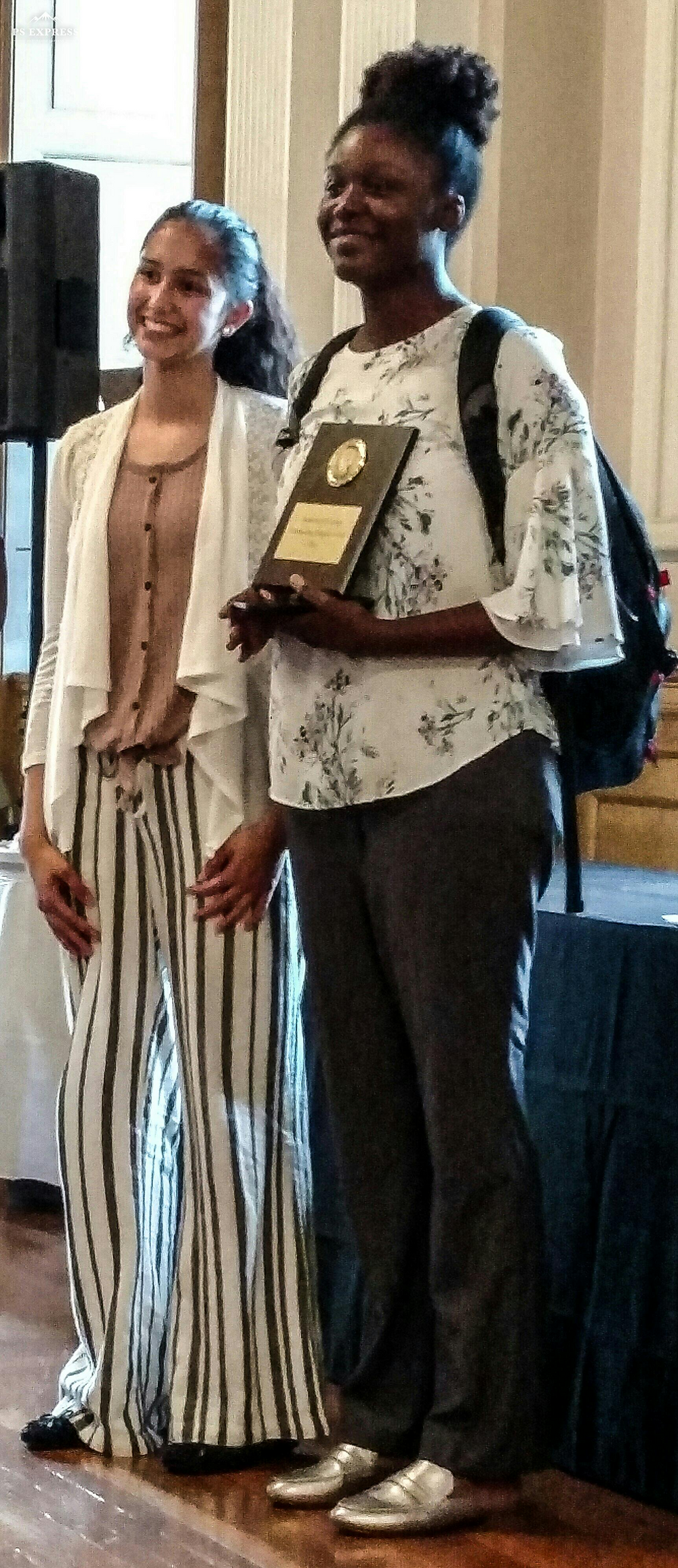 Last year's winner, Asha Verma, gives out the 5th Matthew Ornstein Outstanding Debater Award