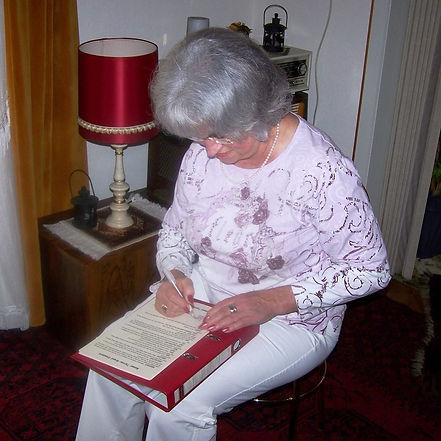 Mrs. Biewer signing 1st American standar