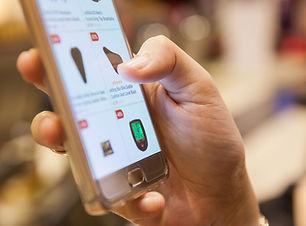 Upclose-Image-of-mobile-ecommerce-shoppi