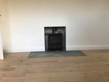 wood burning stove installed into house extension in a belfast project