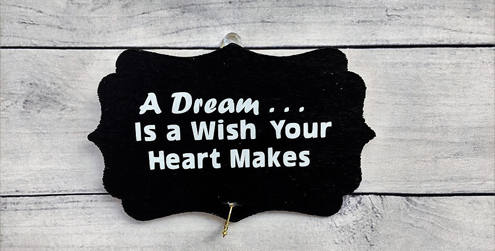 "Black Wooden Wall Plaque ""A Dream is a Wish Your Heart Makes"""