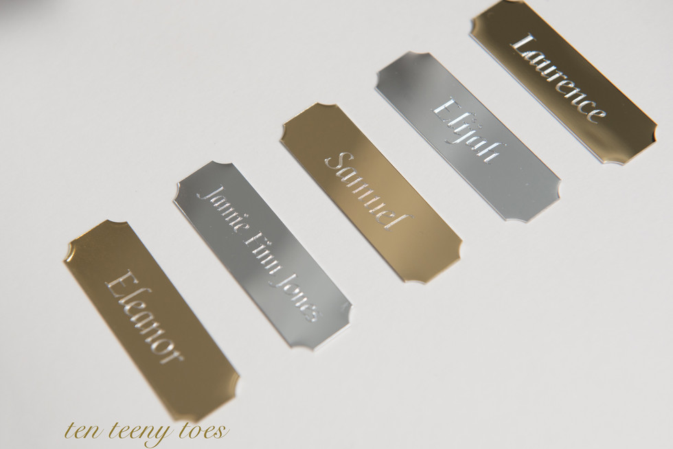 Silver and gold name plates.