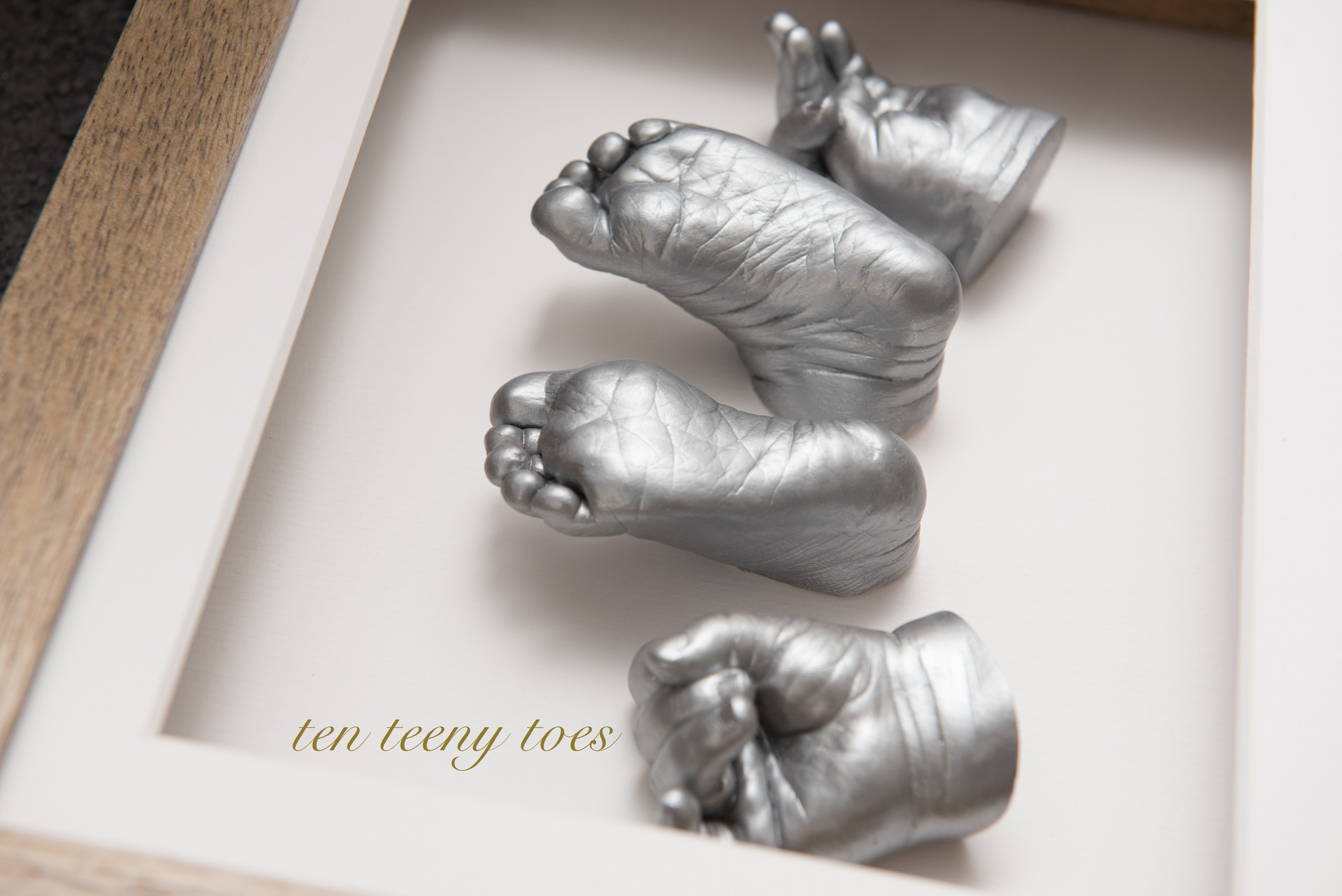 The detail on newborn hand and feet casts.