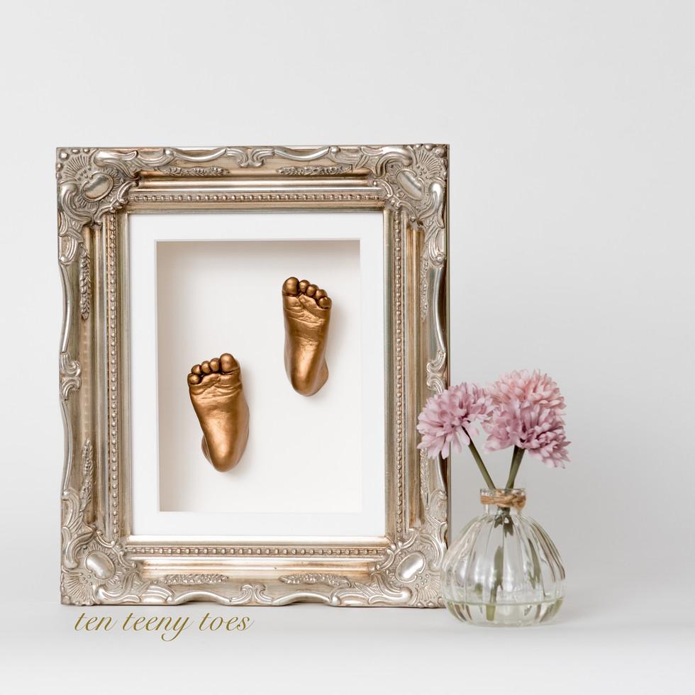 Ten teeny toes in a platinum vintage frame.
