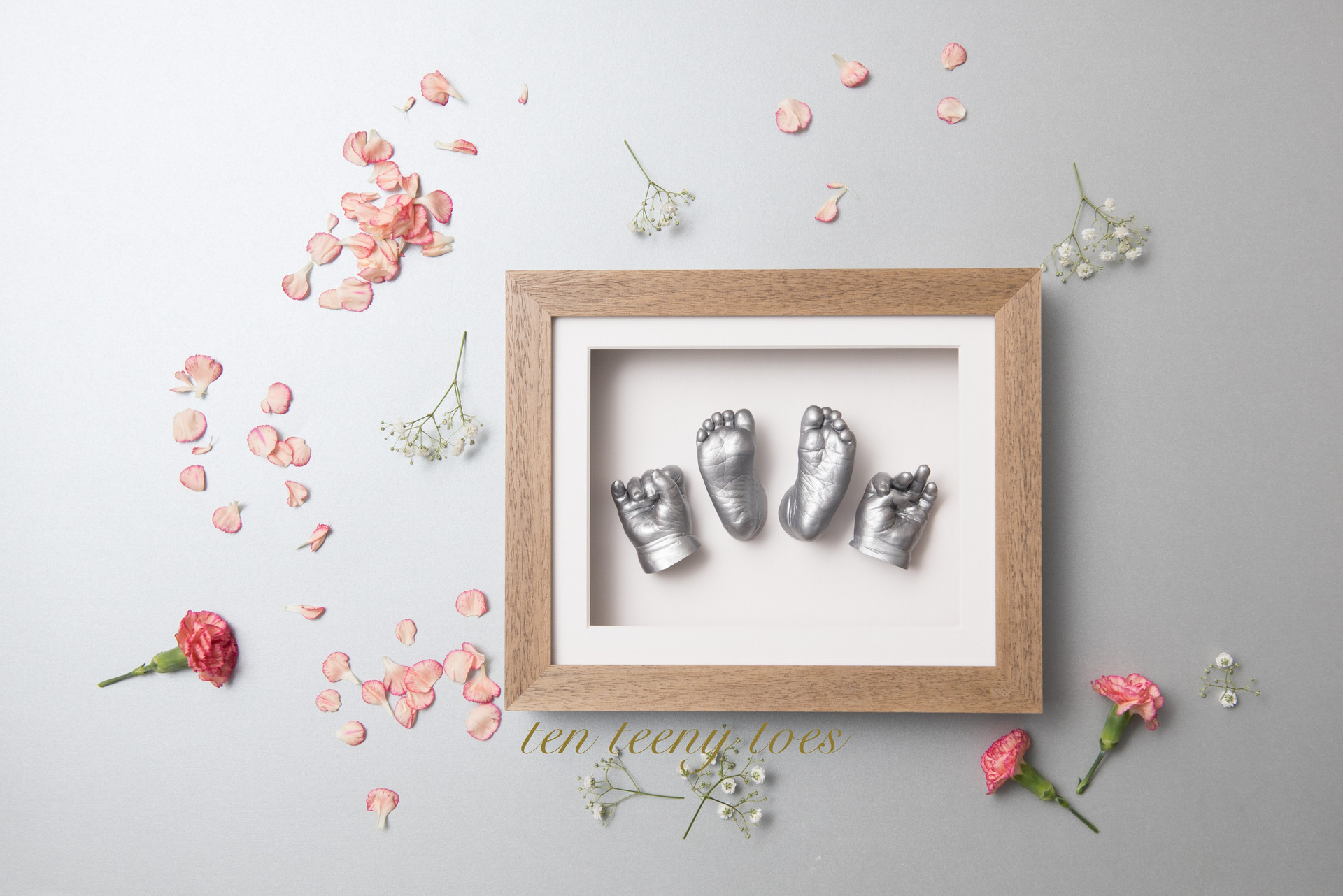 Four newborn casts in a contemporary natural frame.