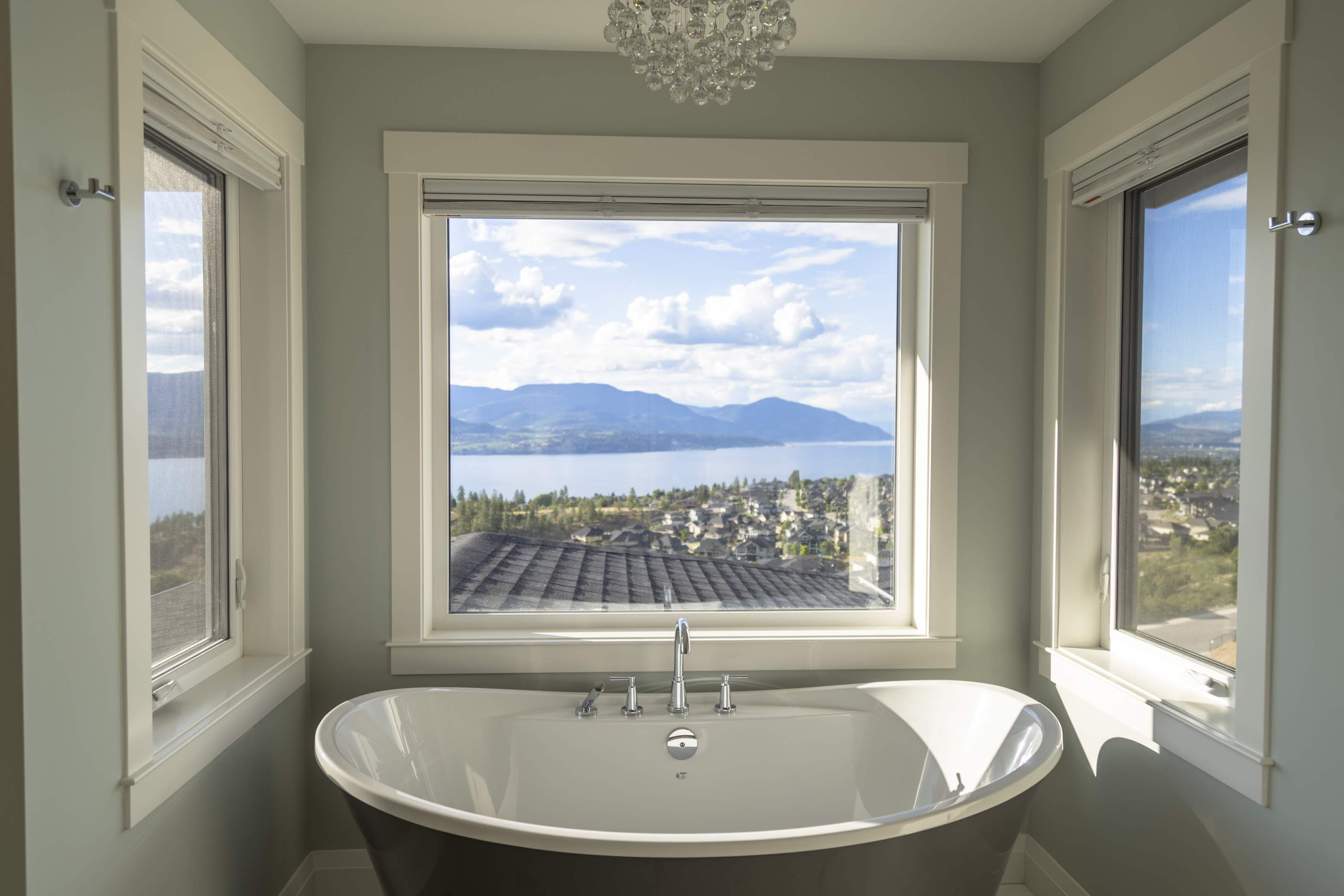 Ensuite bath tub with a lake view built by Impact Builders
