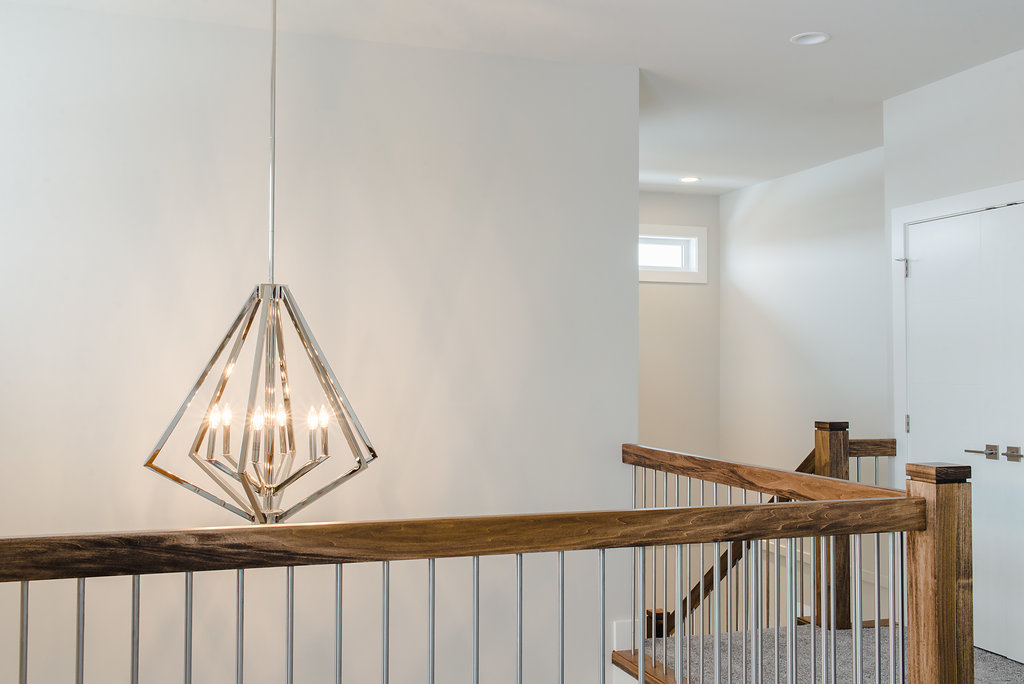 light detail and wood railing by impact builders