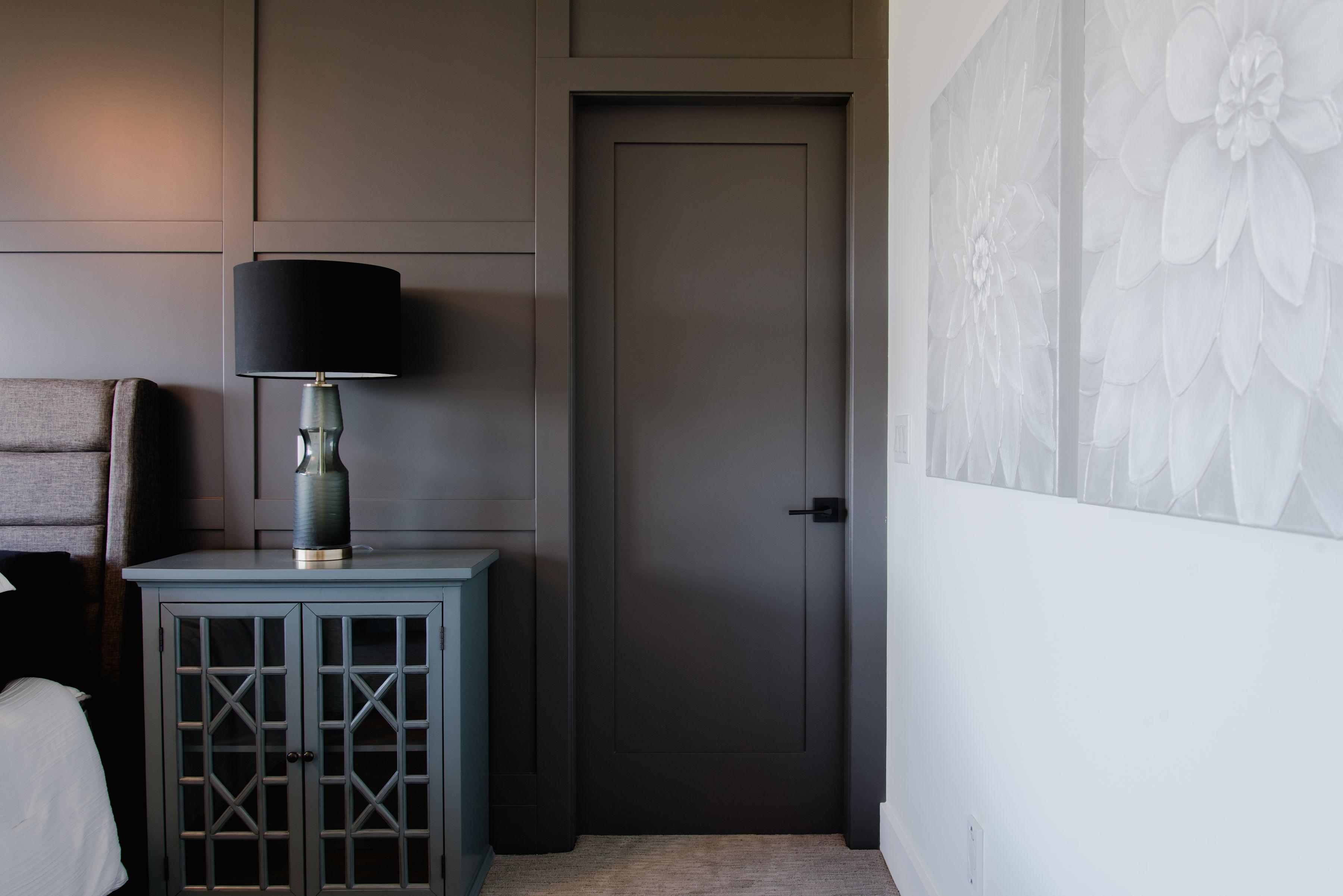 dark feature wall in master bedroomto bathroom by impact builders
