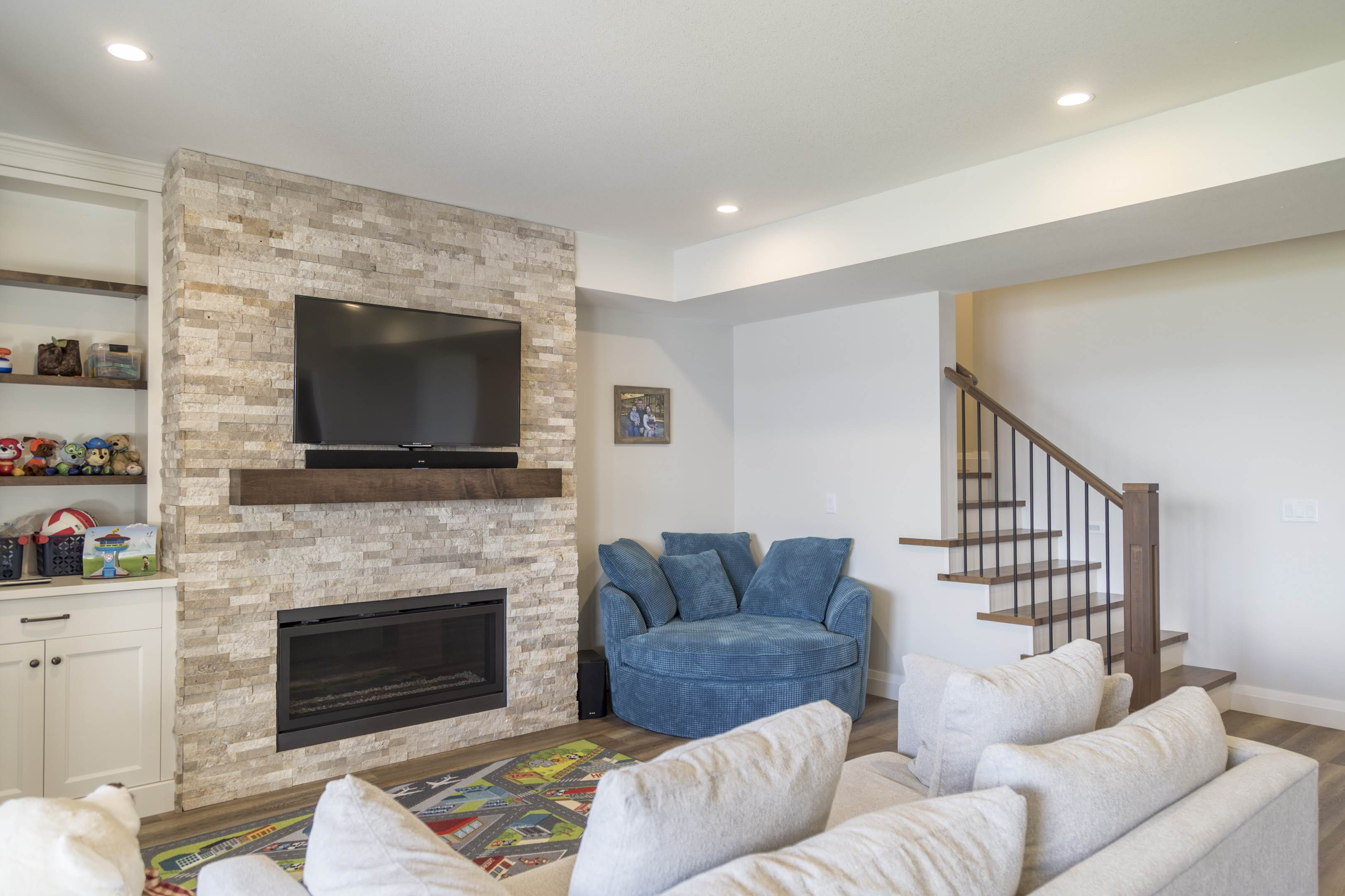 Media room with fireplace built by Impact Builders