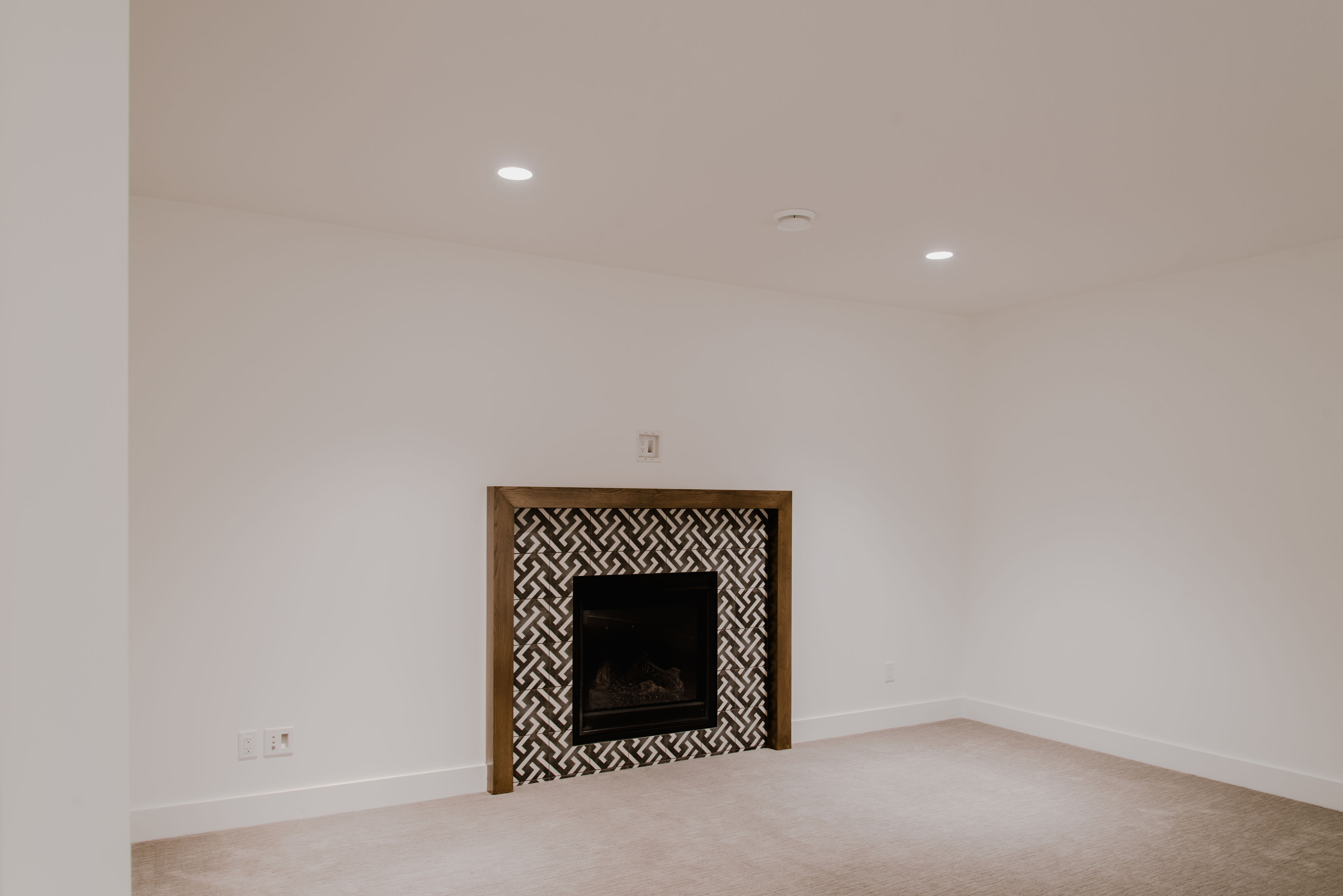 rec room with fireplace by impact builders