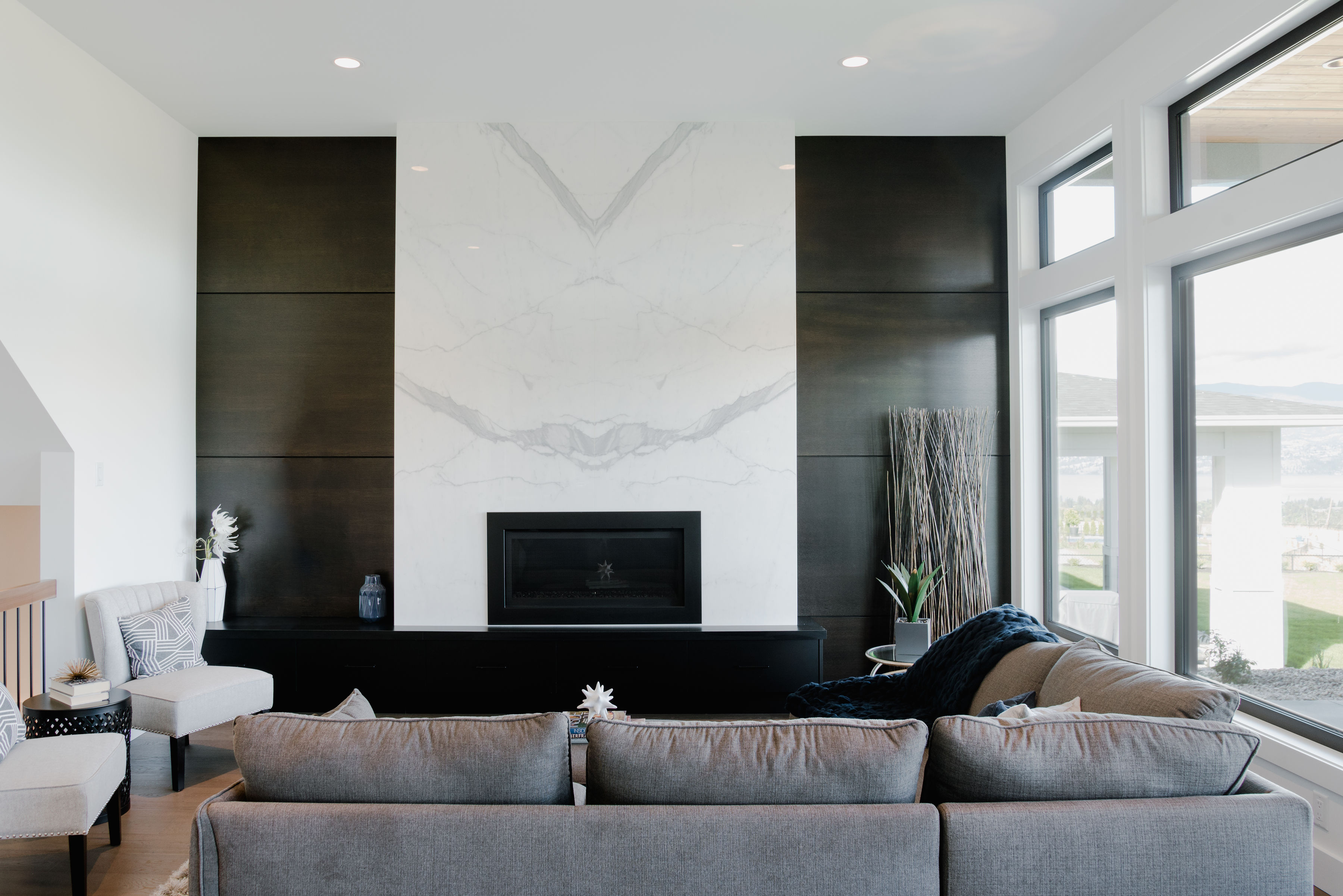stunning marble fireplace and living room by impact builders