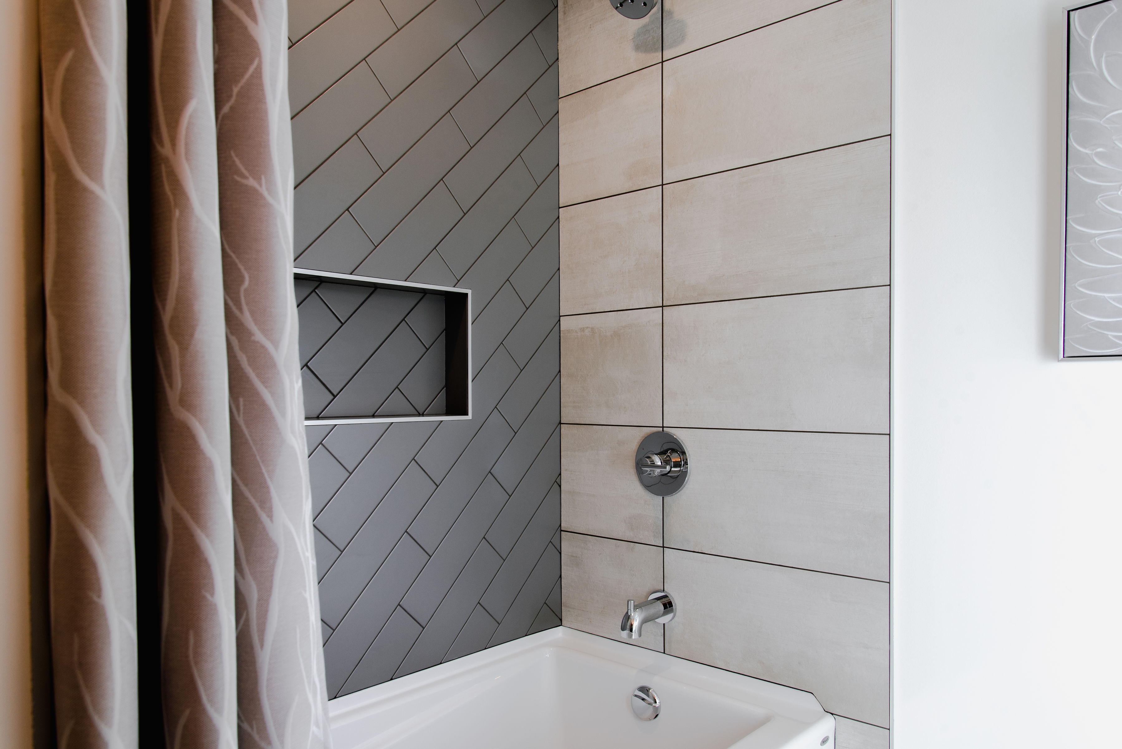 bathroom with subway tile by impact builders