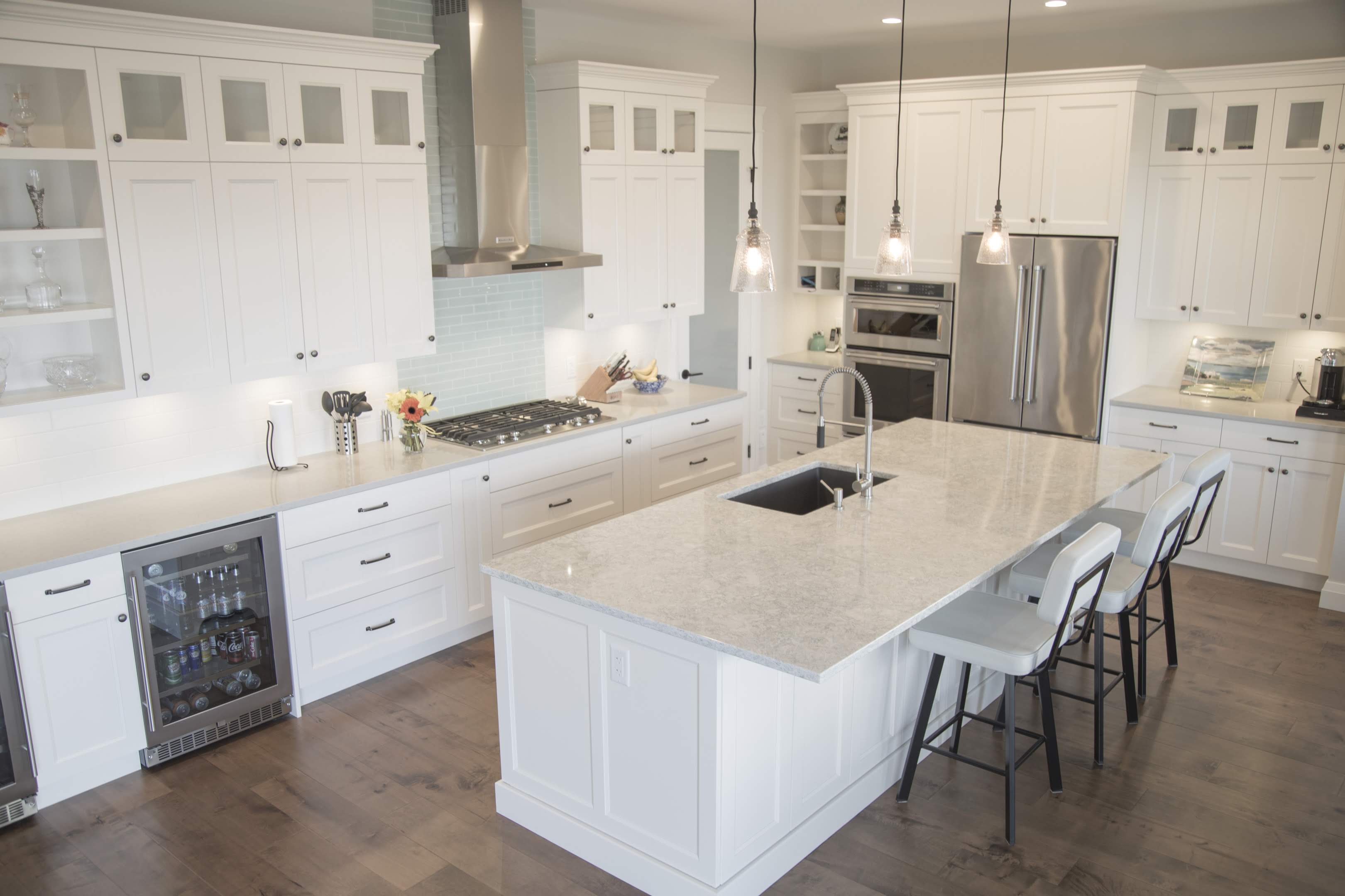 White kitchen with island built by Impact Builders