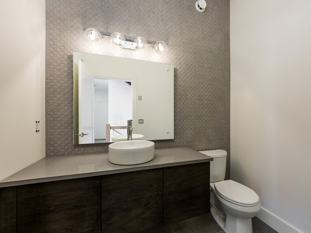 powder room with tile detail built by impact builders