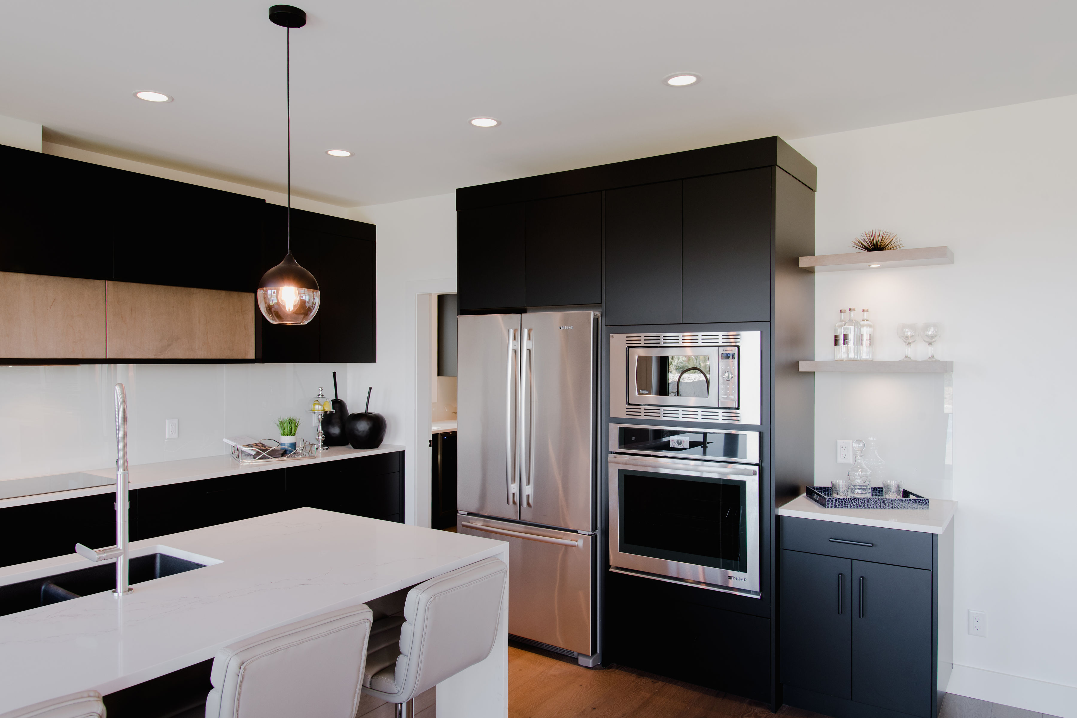 kitchen with matte black cabinets by impact builders