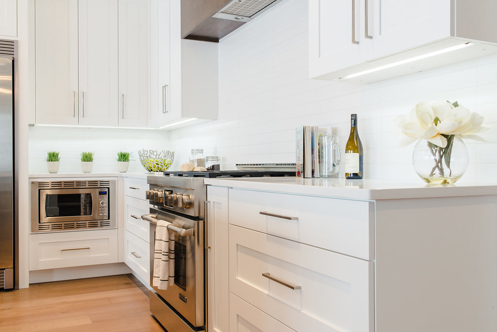 white kitchen built by impact builders