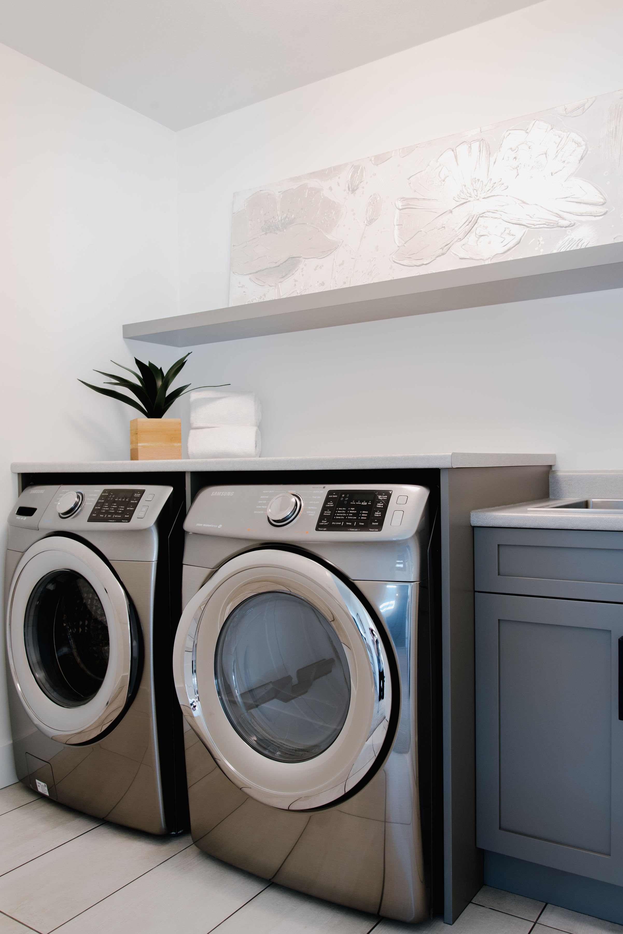 grey laundry room by impact builders