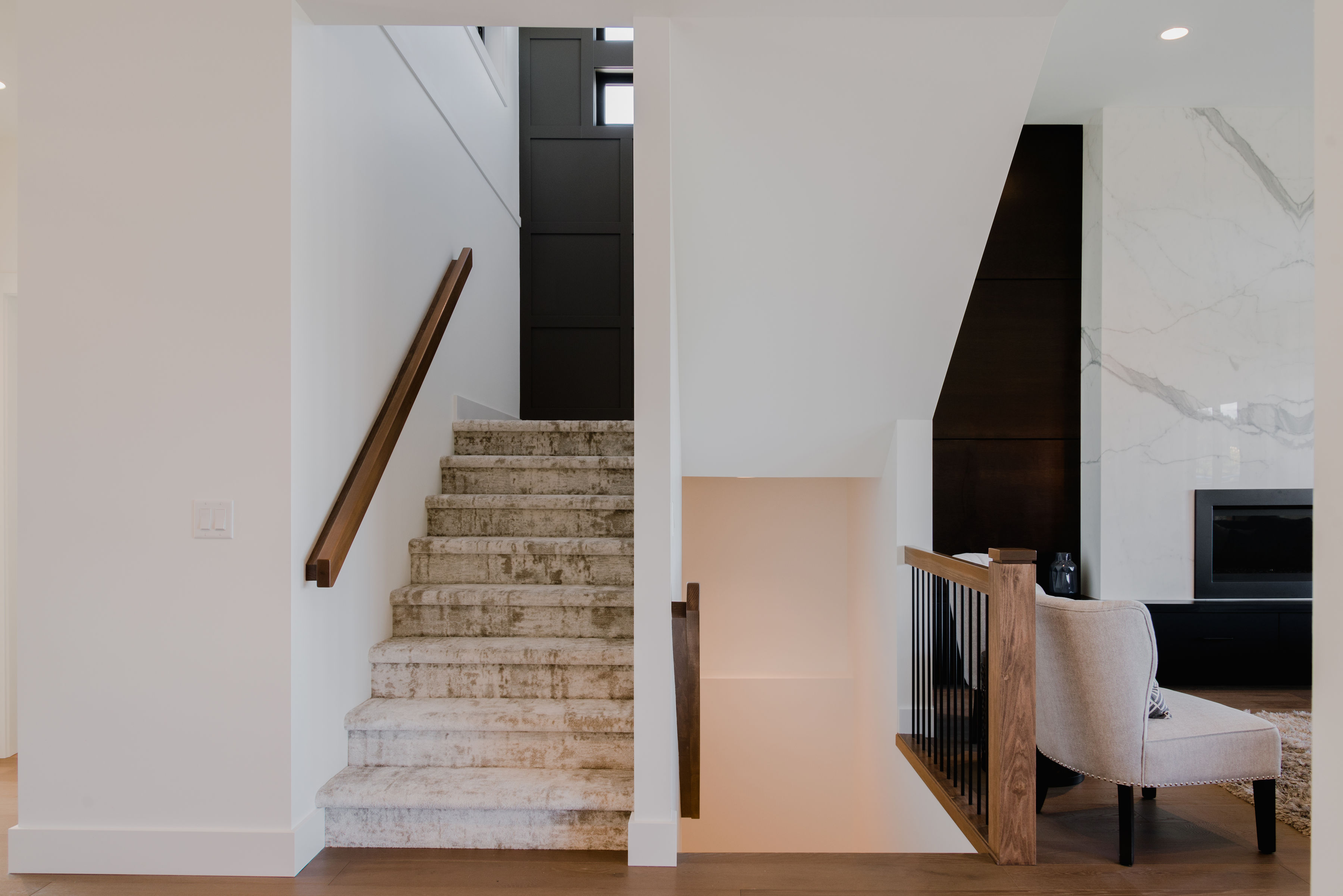 stairs and black feature wall by impact builders