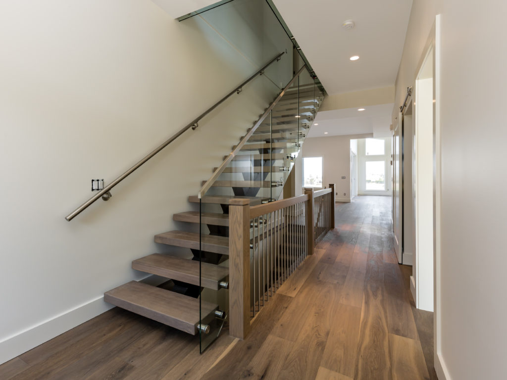 foyer with beautiful unique stairs built by impact builders