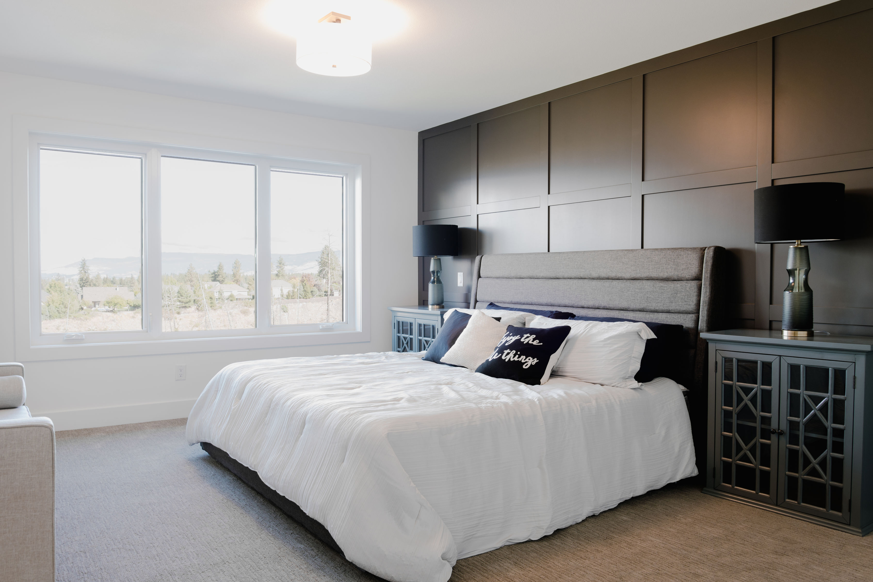 master bedroom and dark feature wall by impact builders