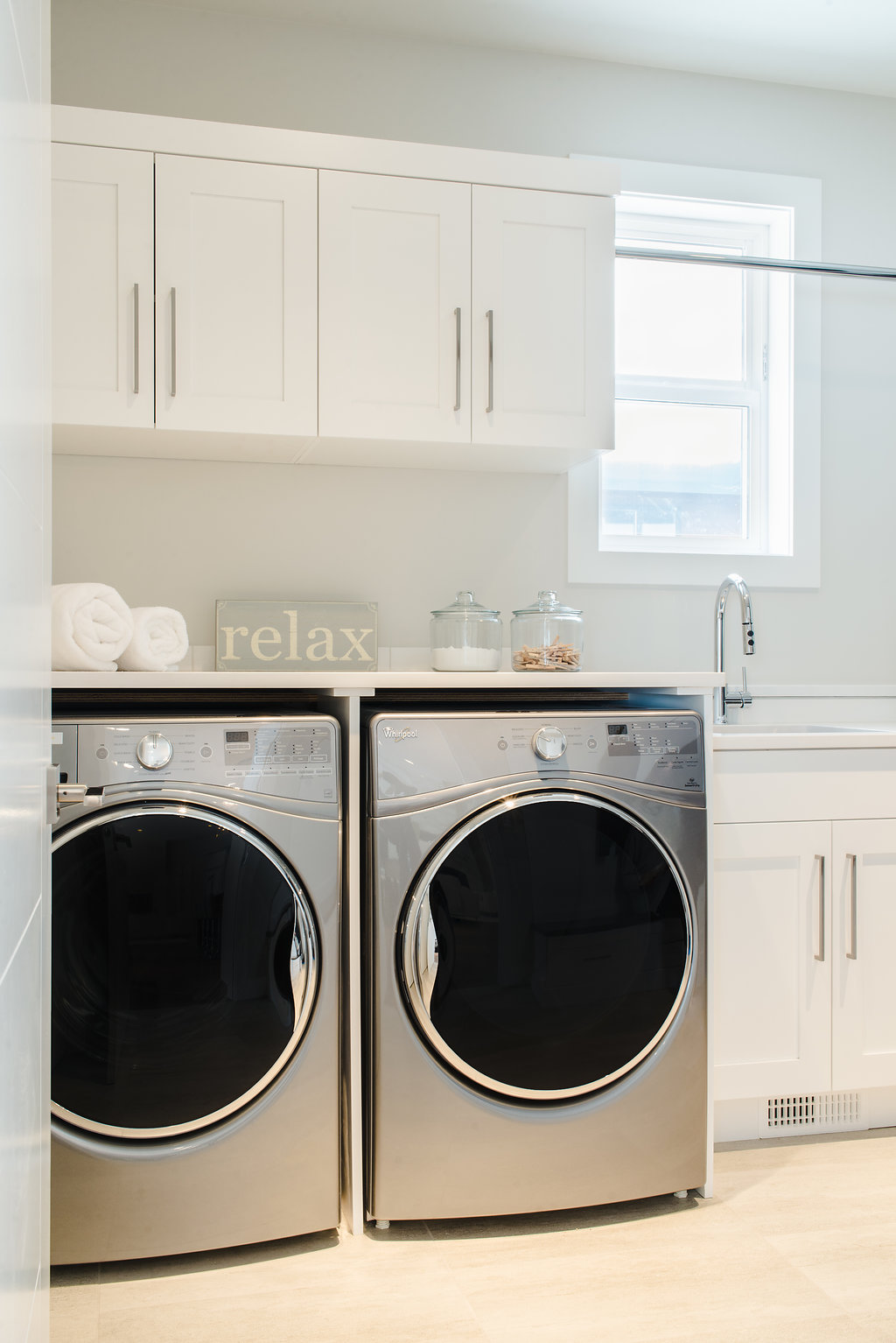white laundry room built by impact builders