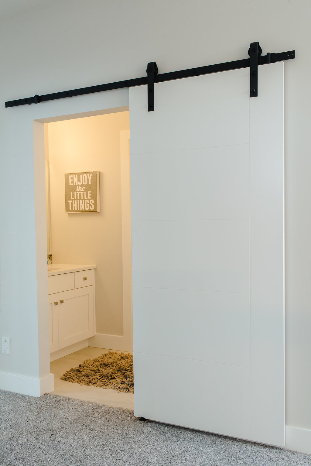 kids bath with barn door by impact builders