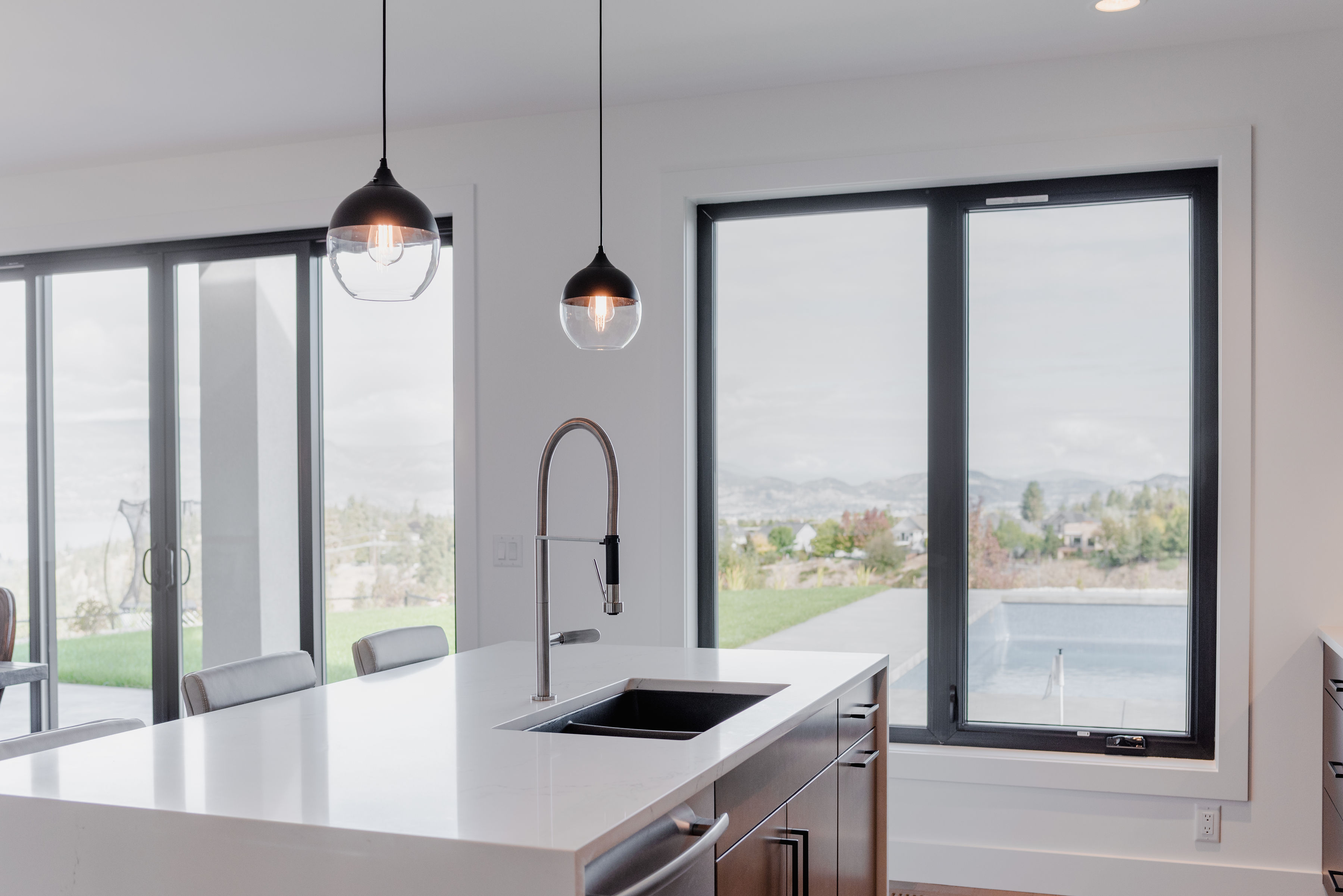 beautiful kitchen with island and view by impact builders