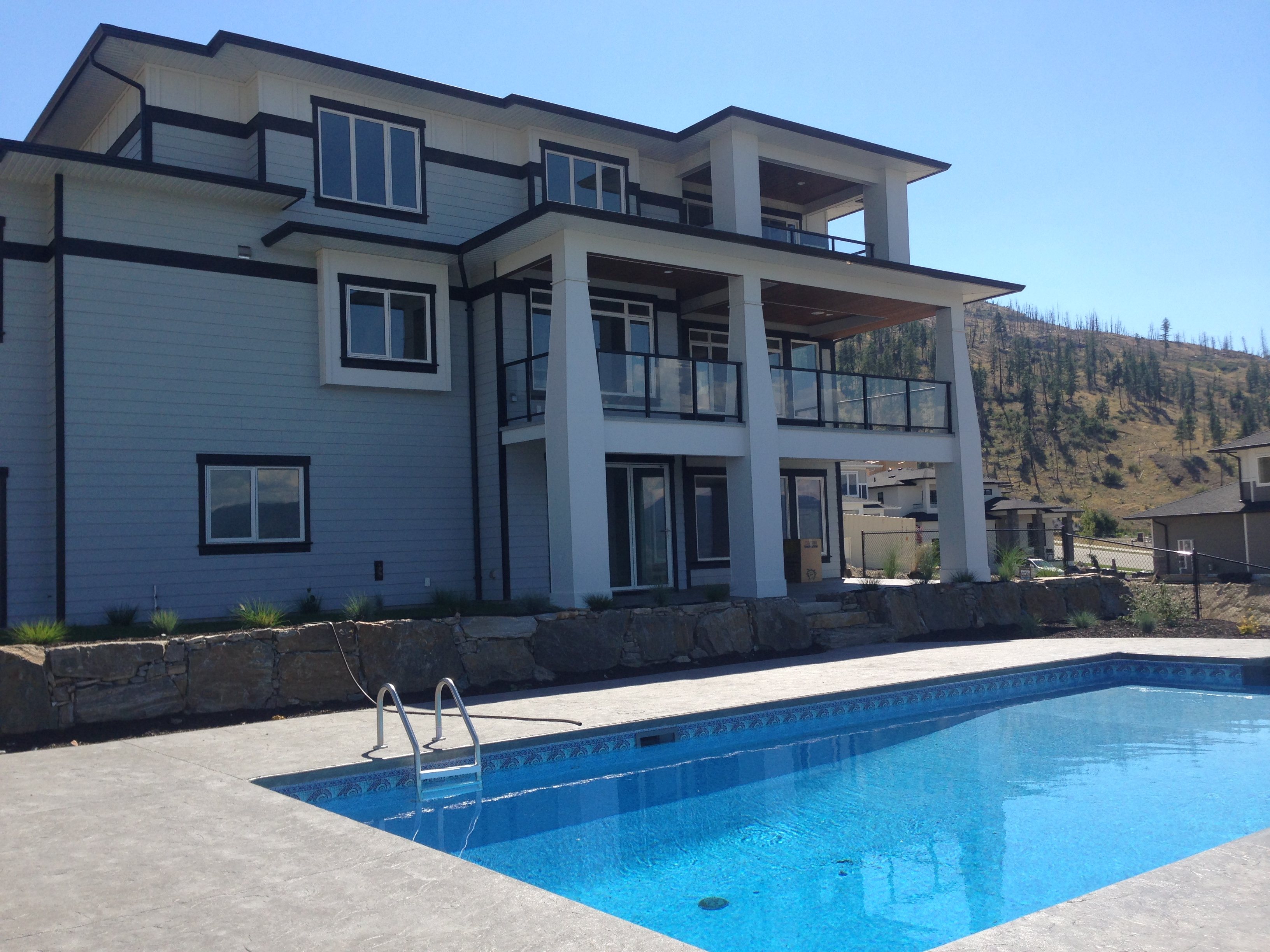 exterior with pool by impact builders