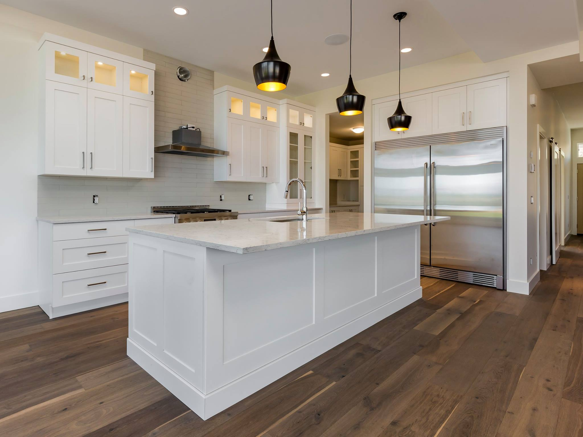 white Kitchen with isalnd built by impact builders